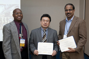 TRB Soil Mechanics Section Chair Njoroge Wainaina (left) recognizes former civil engineering graduate student Kam Ng (middle) and Professor Sri Sritharan (right) for Soil Mechanics Section Best Paper Award. Dordt College student Danielle DeBoer and Iowa State Department of Transportation engineer Kenneth Dunker also contributed to the winning paper (not pictured).