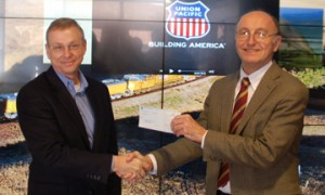 Rick Holmes (left) presents the check to David Jiles (right)