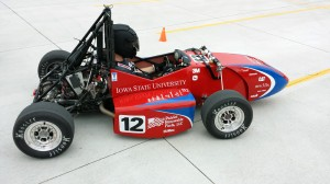 Greg Bott takes the 2014 Formula SAE racer out for another test run across a campus parking lot. This year's racer sports the colors of its primary sponsor, Patriot Renewable Fuels of Annawan, Illinois. Photo by Mike Krapfl.