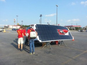 Members of Team PrISUm recharge Phaeton's batteries for the second day of the American Solar Challenge. Photo provided by Team PrISUm.