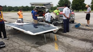 At the Ames checkpoint, solar car team Qazvin Islamic Azad: QIAU HAVIN repairs the brake system on their solar car. Mohammadreza Sadeghein, a member of the car's chase and body team, said the American Solar Challenge is the first race that the Iranian team has competed in the United States.