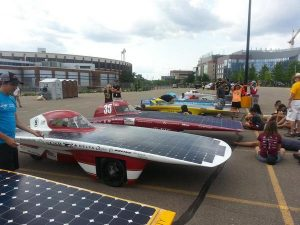 Several solar cars from around the world lined up on the finish line in Minnesota. Photo provided by Team PrISUm.