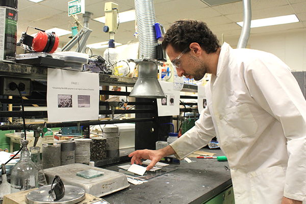 Structural engineering doctorate student Hussam Saleem tests a titanium oxide-filled polymer for use in structural damage detection.