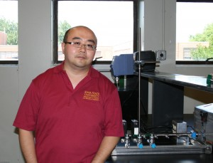 Yue Wu stands in his new research lab.