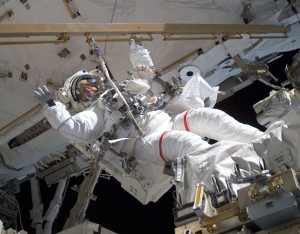 Clayton Anderson waves during a 2007 spacewalk at the International Space Station. Photo by NASA.