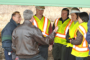 Larson, second from right, meets with Iowa DOT officials and CCEE Professor Terry Wipf at a US-30 bridge inspection in 2009.