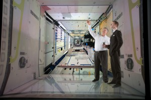 Nir Keren (left) and Tor Finseth, a graduate assistant in aerospace engineering, examine a virtual simulation of the International Space Station inside the C6 at Iowa State University. Image courtesy of Nir Keren.