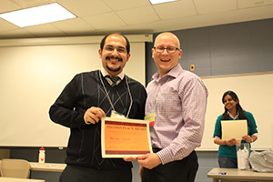 Alireza Sassani (left) places second in the poster competition.