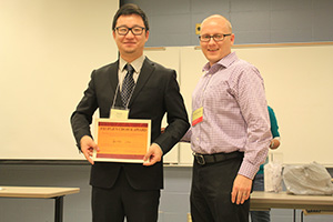 Guyu Shi (left) earns the poster competition's People's Choice Award.