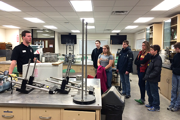 Construction engineering senior Chad Tenold leads a tour in a Town Engineering Building soil technology lab.