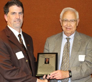 Dr. Andy Hillier, Chair of the Department of Chemical and Biological Engineering (left), presents Dr. Judson M. Harper with his Hall of Fame plaque
