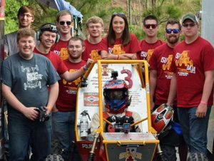 The Iowa State Baja SAE Team recently competed in Auburn, Alabama. Team members are, left to right, Zach Verbeck (far back), Jameson Gavac, Nathan Eick, Derick Whited, Andy Raudabaugh, John Bavlsik, Erik Rasmussen (the driver), Katie Ginapp, Jake Conway, Nick Dugan and Ryan Werner. Larger photo. (Photo courtesy of the Iowa State Baja SAE Team.)