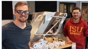 Phillip Molnar, left, Tyler Broich, right, and the rest of the Cyclone Space Mining team are busy assembling their robot for NASA's May 18-22 competition at the Kennedy Space Center. Larger photo. Photo by Mike Krapfl.