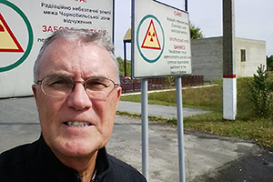 Professor Alleman stands at the Chernobyl 30-kilometer Exclusion Zone checkpoint in Ukraine.