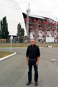Professor Alleman stands near the Chernobyl Nuclear Power Plant on Aug. 24, 2014, as an enormous steel truss arch is constructed to enclose the plant.