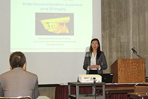 Yelda Turkan, assistant professor of civil, construction and environmental engineering, presents on bridge structural condition assessment using 3D imaging.
