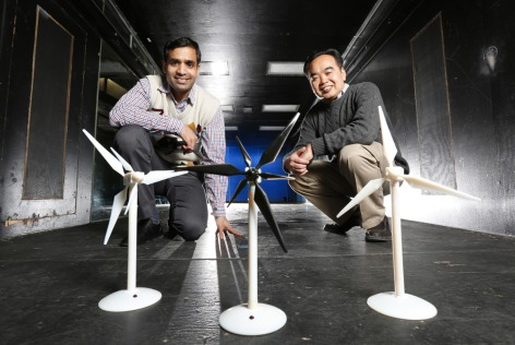Iowa State aerospace engineers, left to right, Anupam Sharma and Hui Hu are working to improve the performance of wind turbines and wind farms. Their research has been supported by the Iowa Energy Center and the National Science Foundation.(Photo by Christopher Gannon)