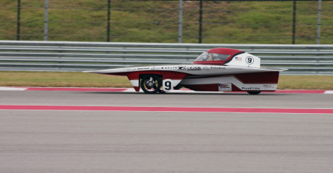 Team PrISUm's solar racing car turns quick laps at the 2014 Formula Sun Grand Prix in Austin, Texas. Larger photo. Photo by the American Solar Challenge.