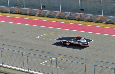 Team PrISUm's Phaëton races down the front straight of the Circuit of the Americas in Austin, Texas. Photo by the Formula Sun Grand Prix.