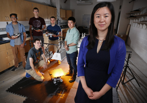 Ran Dai, foreground, is working to develop technologies that will help robots manage their energy use to improve efficiency and battery life. Many students are assisting with the project, including, back row, left to right, Kishan Patel, Justin Vandentop, Adam Kaplan and front row, left to right, Nathaniel Kingry and Yen-Chen Liu. Photo by Christopher Gannon