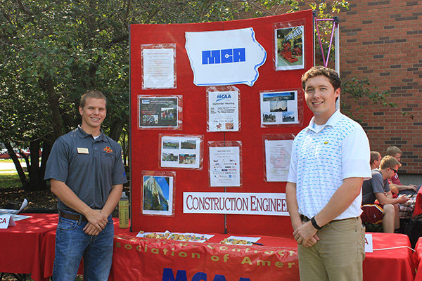 Joe Kern (pictured left), construction engineering senior and vice president of the Mechanical Contractors Association (MCA) Iowa State University chapter, and Pete Christiansen, construction engineering senior and president of the MCA Iowa State chapter, promote their student organization at the CCEE Welcome Picnic Sept. 1.