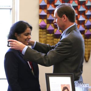 Surya Mallapragada is presented with the medallion for Carol's Chair by Iowa State University Senior Vice President and Provost Jonathan A. Wickert. (Photo by Christopher Gannon/Iowa State University)
