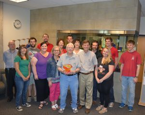McGee (front, center) celebrates with students, colleagues and friends at his 90th birthday celebration
