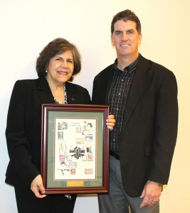 Andy Hillier, CBE chair (right), presents a commemorative Doraiswami plaque to Flytzani-Stephanopoulos.
