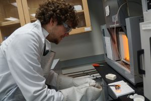German exchange student Johannes Betz conducts research in the glass and optical materials research lab