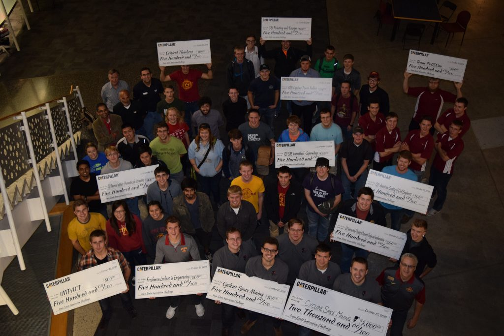 Student groups pose with their jumbo checks after the 2nd annual Caterpillar Innovation Challenge which took place on the Iowa State University campus on October 15, 2016. Photo by Nick Fetty.