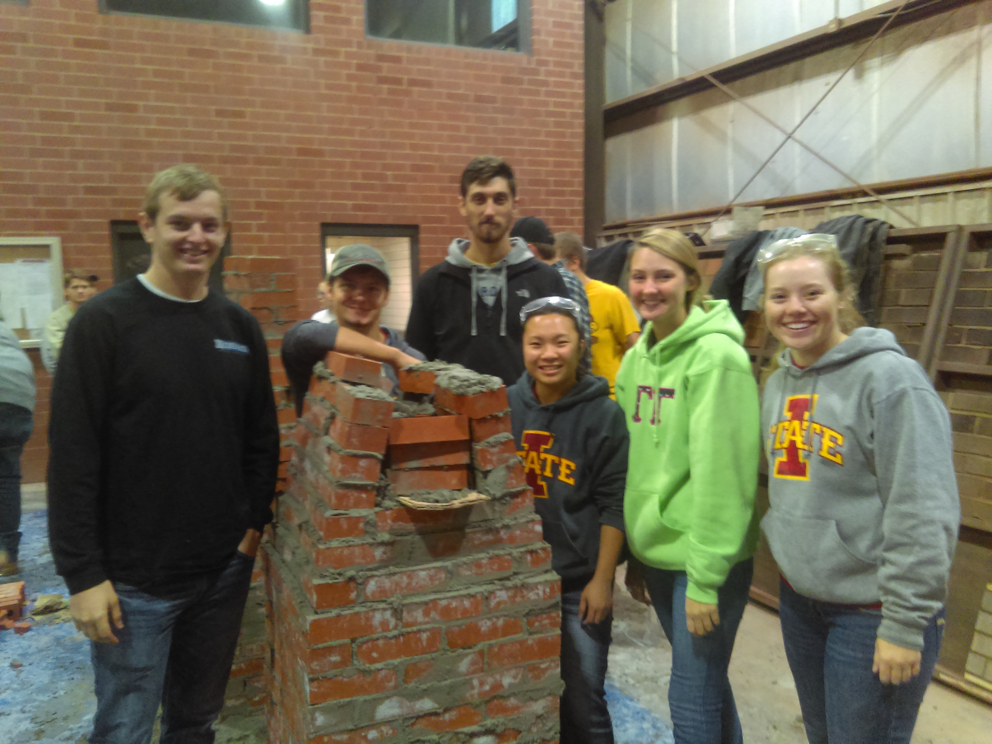 Penton (front middle) and team members with finished campanile (Photo courtesy Brad Perkins)