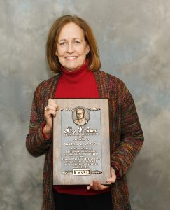 Sandra Larson with Roy W. Crum Distinguished Service Award (Credit: Iowa Department of Transportation)