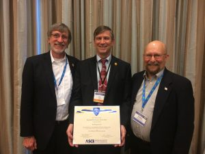 Giroux (center) accepts the Roebling Award at ASCE's Construction Research Council. ISU Construction Engineering Program Professor-in-Charge Chuck Jahren (left) and ISU Construction Engineering Professor Doug Gransberg (right) accompany him. <i> Photo courtesy Paul Giroux </i>