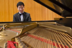 Hu plays a movement of Beethoven's Sonata No. 11 in B Flat Major (Photo by Kate Tindall)