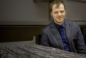 Austin Downey with a model of the sensors detailed in his paper. <i>Photo by Kate Tindall.</i>