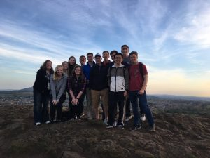 Students stand on the top of Arthur's Seat, an ancient volcano and the site of a large fort that dates back 2,000 years ago. <i>(Photo courtesy Chris Williams).</i>