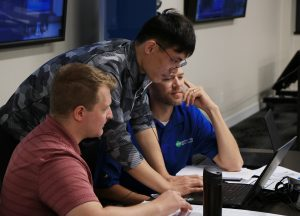 Student Bruce Wang works with two attendees at the CIPCO training.