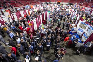 Thousands of students on the floor of Hilton Coliseum talk with company recruiters at the Fall College of Engineering Career Fair.