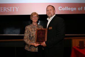 <i> Brad Perkins (right) accepts the Superior Engineering Teaching Award. </i>
