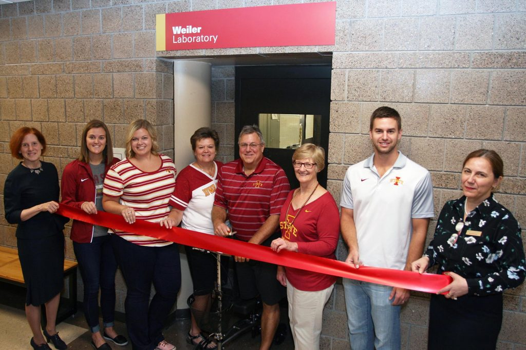 The Weiler family and Iowa State College of Engineering faculty during the ribbon-cutting for the Weiler Laboratory