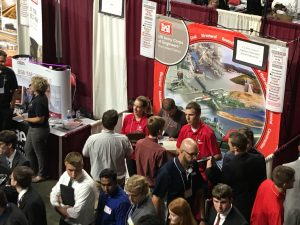 Students gather around the Army Corps of Engineers-Rock Island District Booth to talk with representatives.