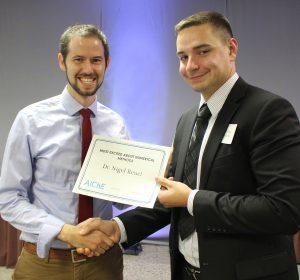 Prof. Nigel Reuel with award