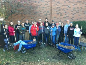 Student members of Engineers for a Sustainable World (ESW), along with friends, gather up for a group photo during Sunday's compost project. <i> Photos by Kate Tindall. </i>
