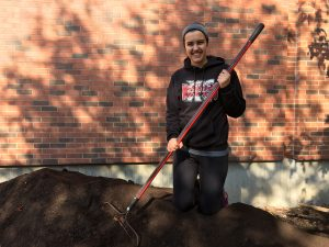 Carissa Moyna <i> (pictured) </i> has enjoyed digging into compost projects since her high school days.