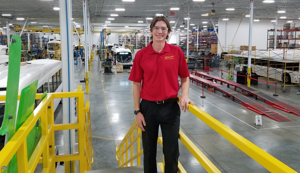 Mechanical engineering senior Ryan Saunders poses at the Proterra electric bus company headquarters in Greenville, South Carolina