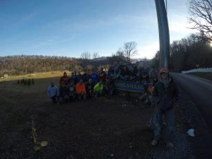 Members of AGC gather at the entrance to Hope Village in West Virginia during their fall 2017 volunteer trip. <i> Photo courtesy Nathan Pals. </i>
