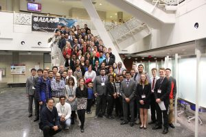 Graduate students, undergraduate students and judges gather for a group photo following awards at the research showcase. <i> Photo by Kate Tindall.</i>