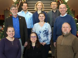 A number of construction engineering faculty gather for a group photo. Faculty members include <i>(front row, from left)</i> Jennifer Shane, Aliye Karabulut-Ilgu (civil/construction engineering faculty member), Brad Perkins. <i>(Middle row)</i> Charles Jahren, Cristina Poleacovschi, Larry Cormicle. <i>(Back row)</i> Michael Perez, Kristen Cetin, David Jeong. <i>Not pictured</i> Jenny Baker and Beth Hartmann.