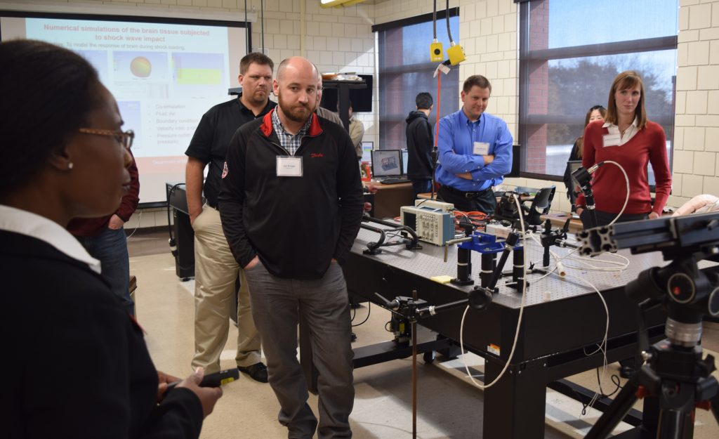 ME assistant professor Sarah Bentil shows off equipment in her lab to the ME Industry Advisory Council during their fall 2017 meeting