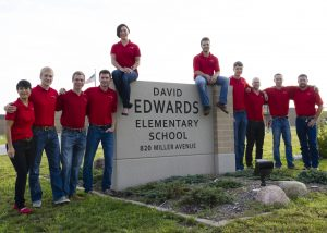 Senior Lecturer Beth Hartmann (left) stands with Cyclone Energy, a student organization that competes the National Electrical Contractors Association Green Energy Challenge each year. Teams submit electrical construction management proposals suggesting improvements to electrical systems in local structures. The team has won numerous national championships.
